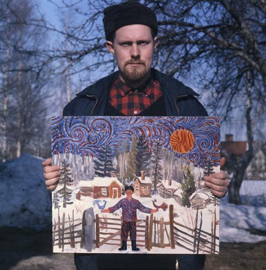 M 42 202:Konstnären Mårten Andersson, Freluga, Bollnäs, Hälsingland, med egen målning. Foto: Hilding Mickelsson